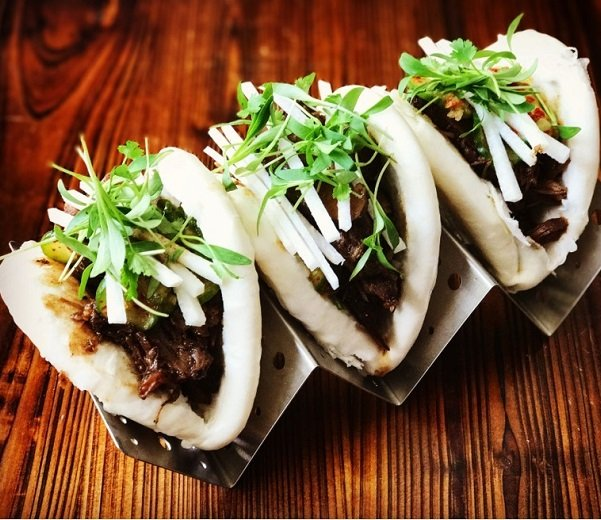Pulled lamb shank bao bun with pickled cucumber