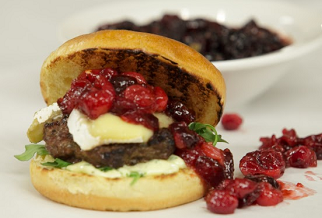 Grilled Australian lamb burger with brie, cranberry compote and roasted jalapeño aïoli