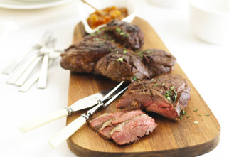 Barbecued sweet and smokey butterflied leg of lamb