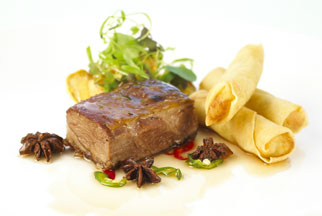 Glazed chai tea smoked lamb shoulder with vegetable spring rolls