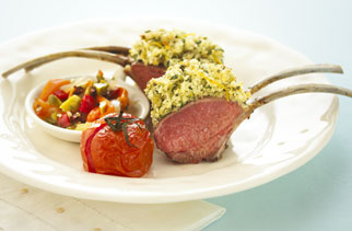 Parmesan lemon and herb crusted rack of lamb with olive muffuletta and roasted roma tomatoes