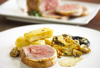 Roasted loin of lamb with thick cut fries and wild mushrooms