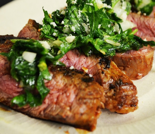 Cajun seared grassfed flank steak with spiced chimichurri sauce