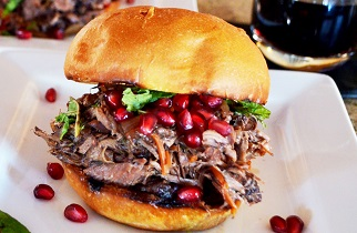 Pulled Lamb Sandwich with Pomegranate Port Wine Sauce on a Toasted Brioche Bun