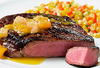 Citrus-Soy Australian Beef Ribeye Steak with Corn and Pepper Medley