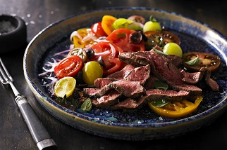 Grilled Aussie flat iron steak with tomato, olive and oregano salad