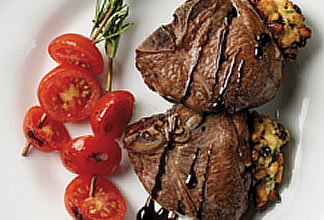 Lamb T-bone Chops with Mediterranean Stuffing and Rosemary Spiked Tomatoes