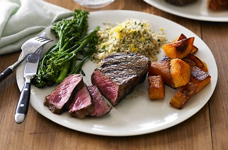 Charred Aussie beef sirloin, pumpkin, broccolini and herb couscous