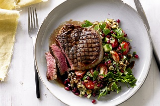 Grilled Aussie beef ribeye steaks with smoky eggplant and pomegranate salad
