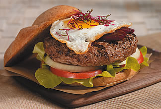 Lamb burger Aussie style with pickled beets and a fried egg