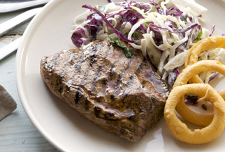 Flat iron steak with onion rings and russian slaw
