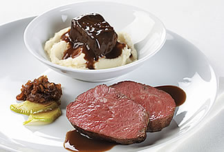 Medallion of Aussie striploin and braised beef shortribs on cauliflower puree and apple and spanish onion jam